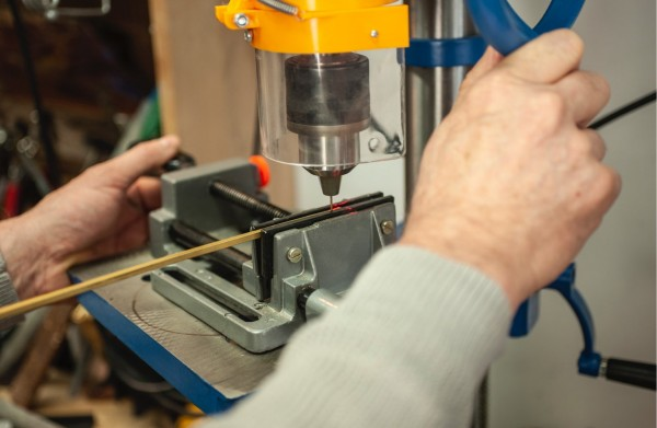 Drilling a hole in a brass tube