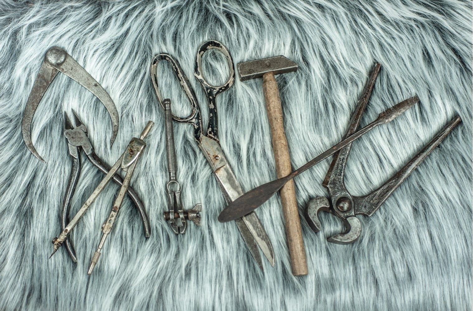 Some of the hand tools we use regularly at work displayed on grey faux fur