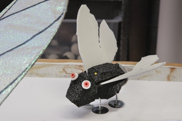 Foam fly with metal feet and orange eyes