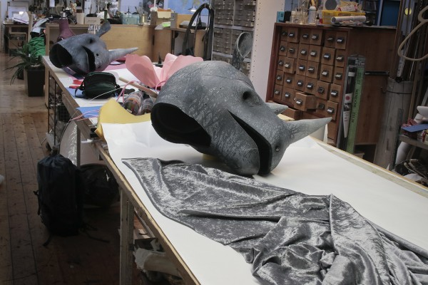 Grey material and two rhinoceros heads at the theatre workshop