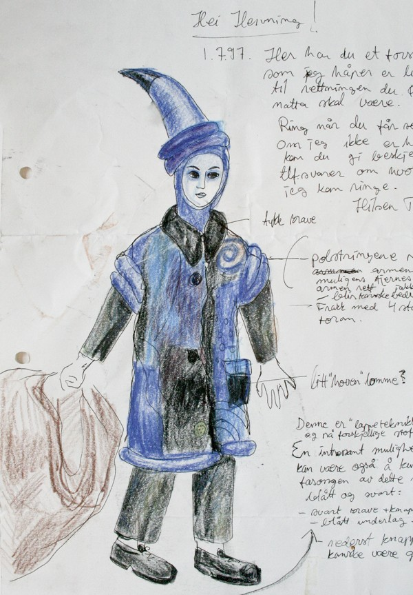 A sketch for a costume including a blue pointy hat and blue coat