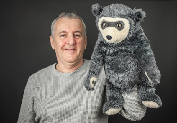 A photo of Bo Bear with Sean as puppeteer