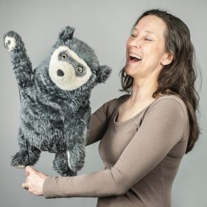 A portrait of Tiina and a waving Bo Bear