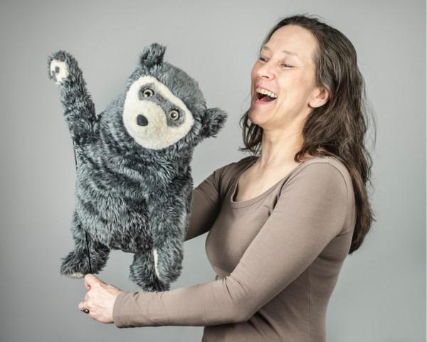 A portrait of Tiina and a waving Bo Bear