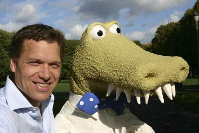Author Henrik Hovland and crocodile Johannes Jensen both showing off big smiles