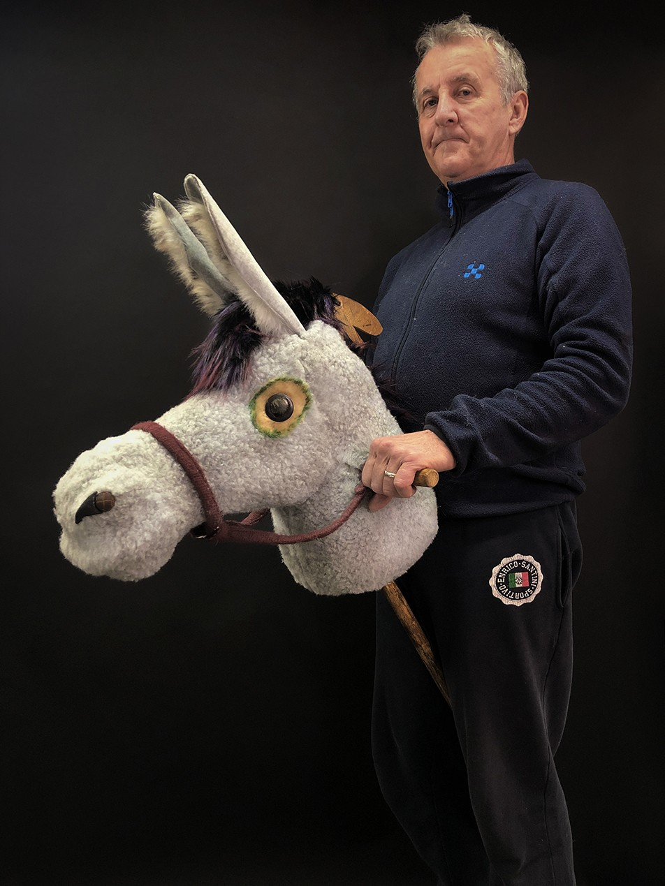 A finished grey hobby donkey in profile.