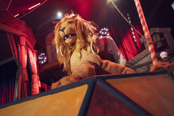 The lion puppet onstage.